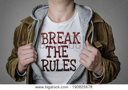Man showing Break the rules tittle on t-shirt. Positive attitude and success concept.