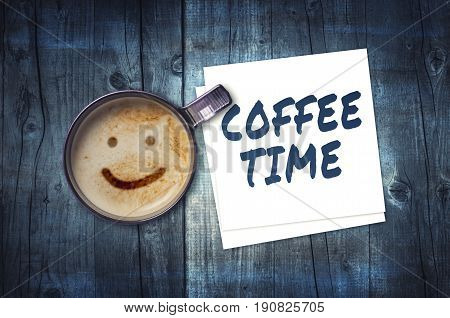 Cup of coffee and coffee time note