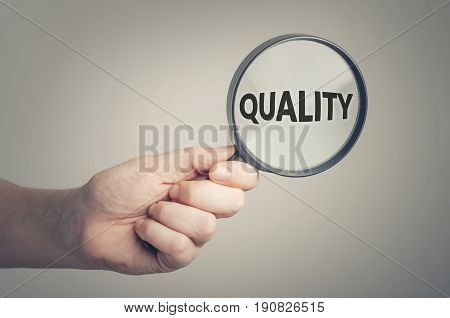 Looking for quality. Conceptual image of quality management or quality control.