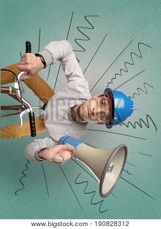 Extreme young cyclist with doodle on the background