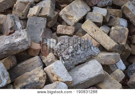 Old bricks on construction site. Close-up of wreckage building brick wall.