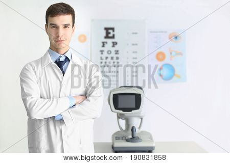 Handsome male ophthalmologist in clinic
