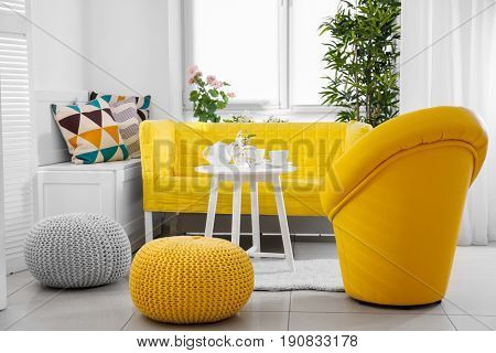Beautiful modern veranda with cozy furniture