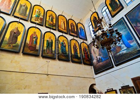 JERUSALEM, ISRAEL - DECEMBER 26, 2016: Icons in Russian Orthodox Church of St. Alexander Nevsky in complex of Alexander courtyard of the Imperial Orthodox Palestine Society in old city of Jerusalem.