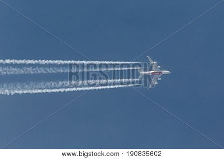 TISZAFURED, HUNGARY - APRIL 18, 2016: Emirates Airbus A380 passing overhead on route from London to Dubai. Emiratest is the biggest operator of A380s.