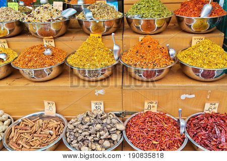 Spices at Mahane Yehuda market in Jerusalem. On tablets are written the prices for cinnamon, pepper, chili, ginger, mushrooms, turmeric and various mixtures of spices for different meats