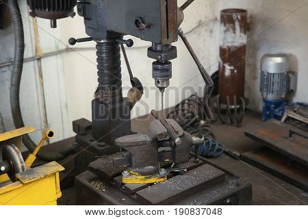 Grip and drill for metalworking in shop