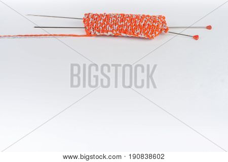 Knitting wool and knitting needles. Ball of wool with spokes for handmade knitting on wooden table