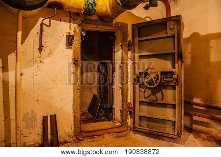 Old rusty hermetic door with valve of soviet bomb shelter