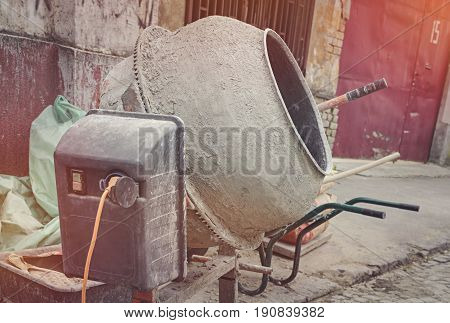 Concrete mixer left after working time at the construction site.