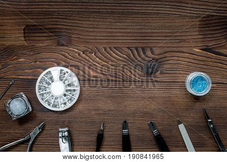 manicure and hands care set with nippers, cuticle scissors on wooden table background top view mock-up