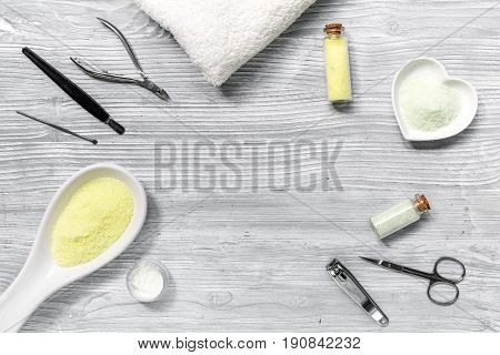 Spa composition on wooden desk with salt and manicure set copyspase top view.