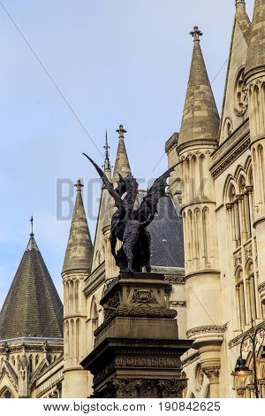 LONDON, GREAT BRITAIN - SEPTEMBER 19, 2014: The Temple Bar monument is a bronze griffin on a high pedestal on the border of the City and Westminster.