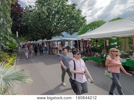 Montreux, Switzerland. 3rd June 2017. People are walking through a street market at Montreux in Switzerland.