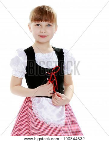 A sweet little blonde with long hair braided in a bun and a short bangs on her head. In a beautiful dress with a white apron.