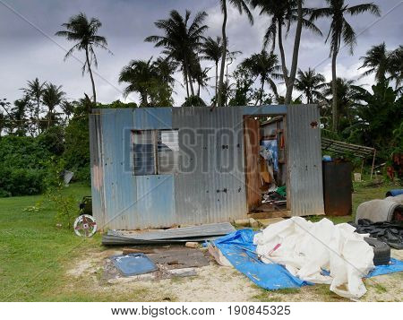 Damaged house blown by a typhoon A damaged house missing its roof after typhoon Soudelor blew it away on the night of August 2, 2015 in Saipan, Northern Mariana Islands.