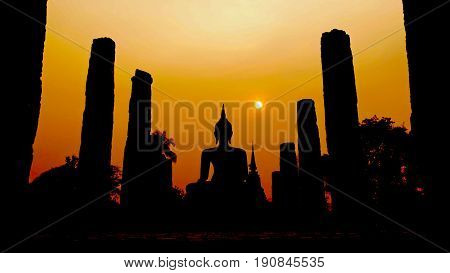 Silhouette of Wat Mahathat Temple at sunset, Thailand Sunset silhouettes of the Wat Mahathat Temple in Sukhothai Historical Park, Thailand, a UNESCO Heritage Site.