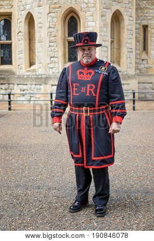 London, UK - 7 June 2017: Beefeater, or Yeoman Warder in formal undress, in the courtyard of the Tower of London.