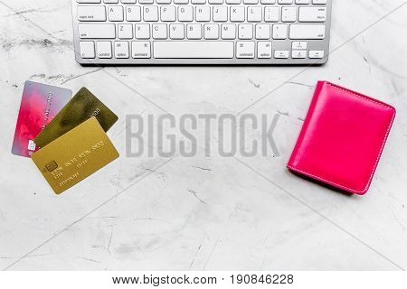 buying products with credit cards andkeyboard on light table background top view space for text
