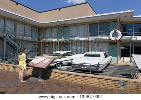 Memphis, TN, USA - June 9, 2017: Young woman in front of room 603 of Lorraine Motel where Dr. Martin Luther King Jr.was assassinated, and now site of the National Civil Rights Museum