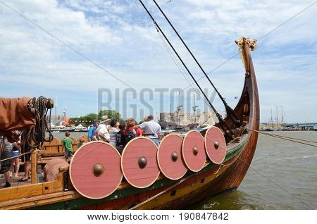 BAY CITY MI - JULY 17: Visitors explore the viking longship Draken Harald Harfagre at the Tall Ship Celebration in Bay City MI on July 17 2016.