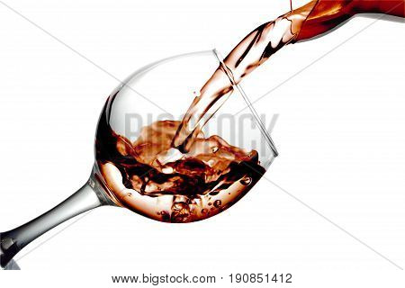 Red Dry Wine Pours Into A Wineglass On A White Background