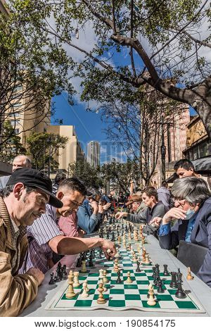 Bogota, Colombia  - February 4, 2017 : Chess players on Carrera Septima in Bogota capital city of Colombia South America