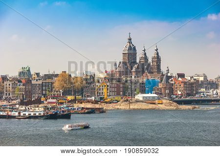Amsterdam City Skyline At Harbour And Basilica Of Saint Nicholas, Amsterdam, Netherlands