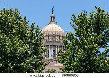 Oklahoma State Capital dome shot thru the trees.