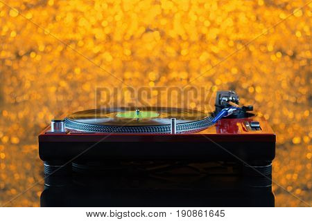 Dj Turntable On Yellow Background Out Of Focus