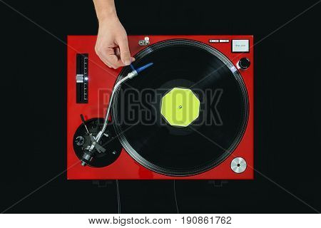 Dj Turntable Playing Music With Hand