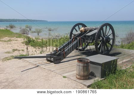 A cannon on the shore of Lake Huron and Lake Michigan.