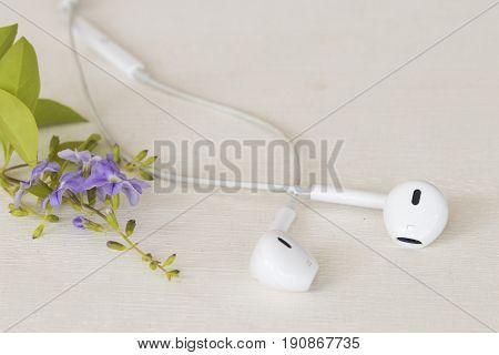 white earphone for listen and speak on background white