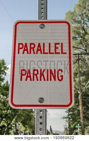 Red and white parallel parking sign found in a small town