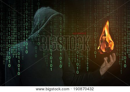 Hacker show a fireball on his hand with green digital binary in foreground. Fireball Adware Infects a Quarter Billion PCs designed to hijack browsers to change the default search engine.