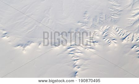snowy land. view from the airplane . A photo