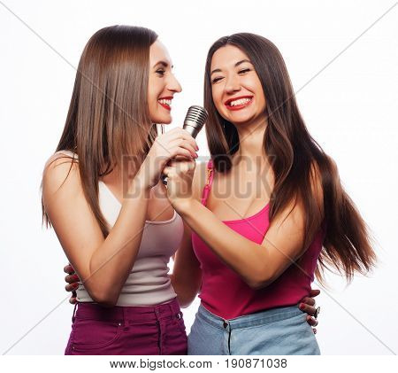 life style, happiness, emotional and people concept: beauty hipster girls with a microphone