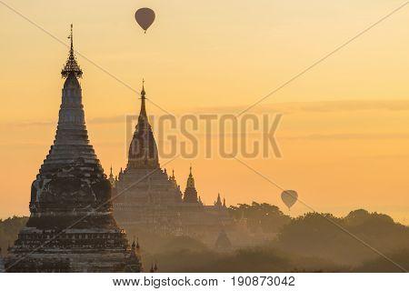Hot-air balloons flying over Ananda Temple at Early Morning Bagan Myanmar