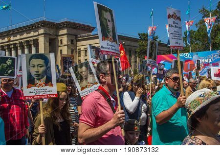 ALMATY KAZAKHSTAN - MAY 9: Immortal Regiment march during the Victory Day celebrations victory in the World War II) in Almaty Kazakhstan Park 28 Panfilov Guardsmen May 9 2017.