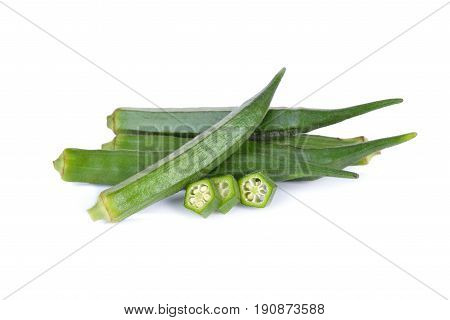 whole and cut fresh okra on white background