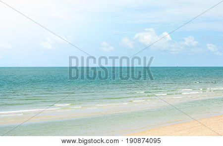 Beautiful sand beach with little wave.Nature sand beach background.Thailand beach and sea with sky background