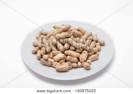 Dried peanuts on white plate at on white background