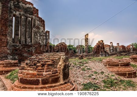 Wat Mahathat with Ruins of stupa and statue in the ancient Thai temple in Ayutthaya Historical Park.