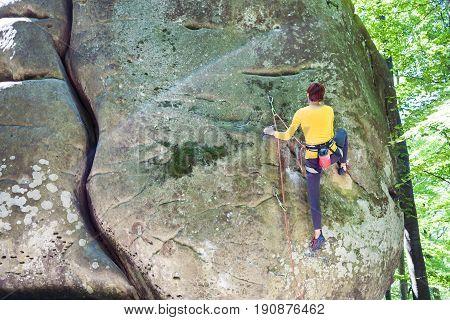 Girl Is Climbing The Rock.