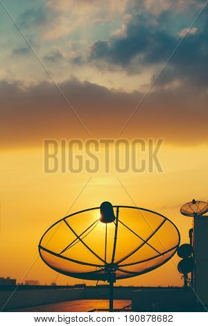 Satellite Dish In Golden Sunset Sky Background.
