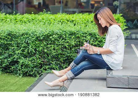 Student Writing At Park, Working Outdoor Women Work Business Job Writer Write Text In Notebook.