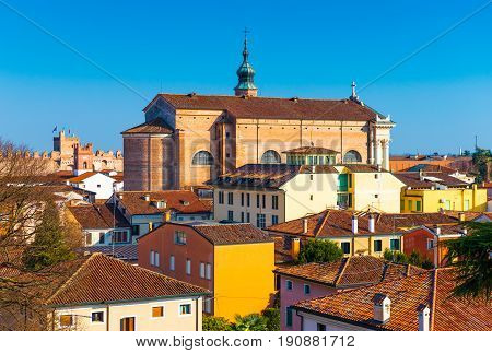 Old cathedral in the center of the walled city of Cittadella. Panorama of the small Italian town. Cityscape against the clear blue sky Italy.