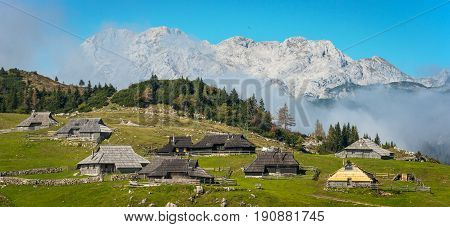 Mountain village in Alps, wooden houses in traditional style. Velika Planina, Kamnik, Slovenia