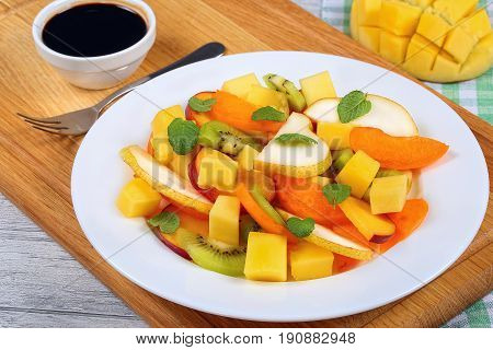 Pear, Kiwi, Apricot,mango And Peach Salad