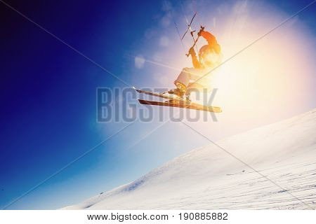 Skier with a kite on fresh snow in the winter in the tundra of Russia against a clear blue sky. Teriberka Kola Peninsula Russia. Concept of winter sports snowkite on ski.